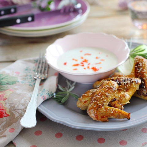 BBQ  chicken wings with sesame seeds and yoghurt  dip